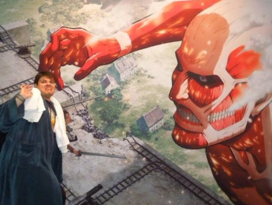 Fighting the Colossal Titan at Sydney Supanova, (cosplaying as Arthur Dent - Hitchiker's Guide to the Galaxy.)