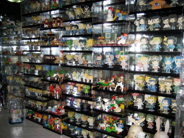 Smilerobinson's room with her 5cm models displayed in glass cases.