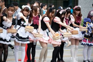 Maids line up in Japan for  Uchimizu - For a further look at the Akihabara city head over to http://site.saikit.com/akihabara-anime-heaven/