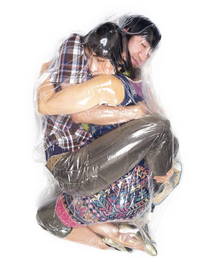 couples-risk-their-lives-to-be-wraped-up-in-plastic-bags-for-photos-in-tokyo-57bc2f7a7ea1c__880-700x852