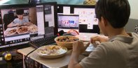 14-year-old makes up to $1,500 a night eating dinner in front of a webcam in South Korea – Source: Business Insider